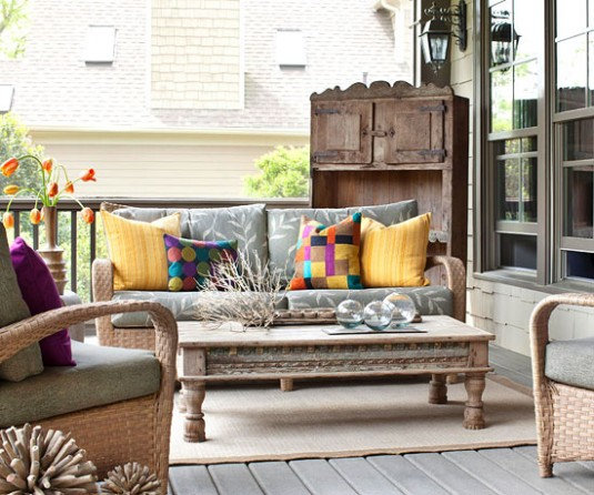 patio furniture-gray sofa and colorful pillows