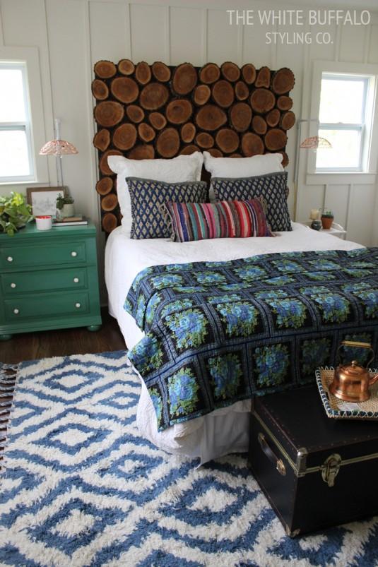 rustic-bohemian-master-bedroom with wooden headboard