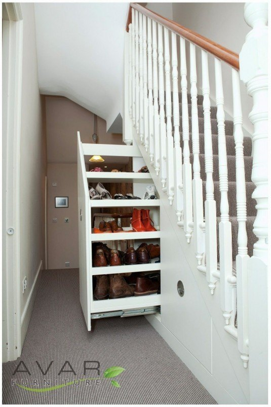 Stylish-Under-Stairs-Storage-Designs-with-storage-and-shoes-also-white-wooden-staircase-astonishing-storage-under-stairs-designs-918x1377
