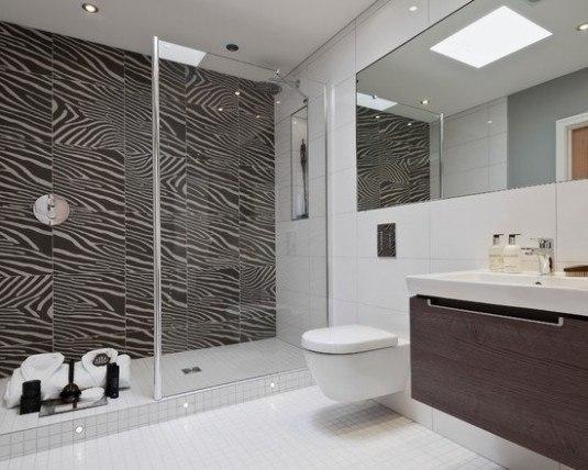 modern-zebra-print-bathroom-ideas-with-glass-shower-area-and-dark-vanity-with-undermount-sink-also-modern-mirror-and-bright-neon-lighting