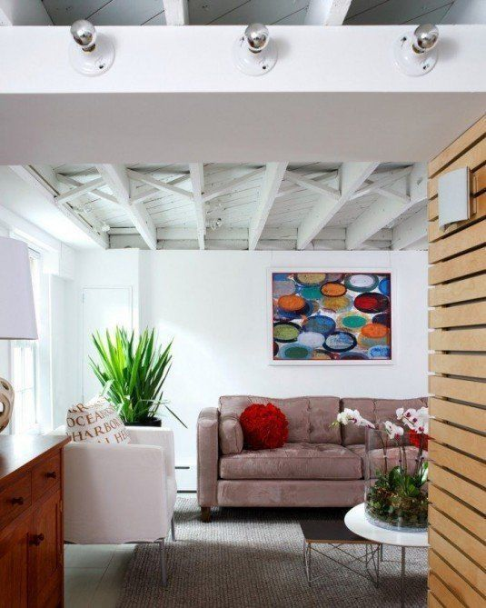 basement-blanket-insulation-Basement-Modern-with-armchair-Art-coffee-table-700x875