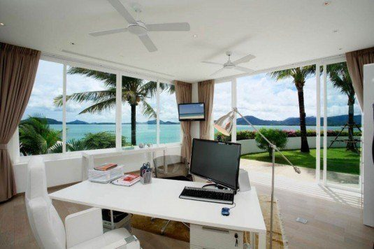 tropical-home-office-design-with-white-desk-and-white-chair-also-open-style-and-lovely-garden