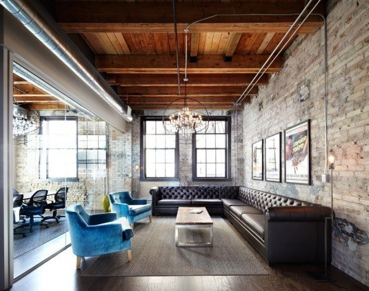 Astounding-Hire-Interior-Designer-Ideas-in-Living-Room-Industrial-design-ideas-with-blue-armchair-brick-brick-wall-chandelier-chesterfield