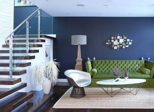 Bold-green-sofa-along-with-the-timeless-Platner-armchair-in-the-living-room