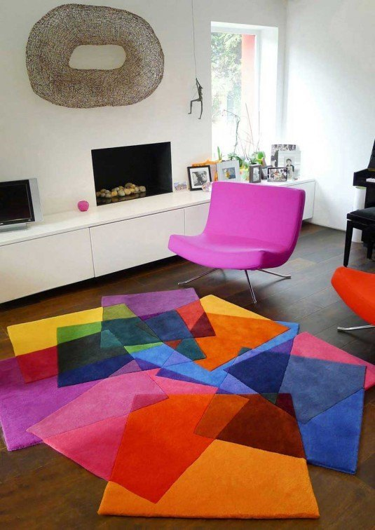White-Living-Room-with-Pink-Chair-and-Colorful-Rugs