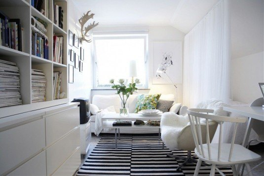 minimalist-scandinavian-interior-design-with-white-painted-oak-wood-book-shelves-and-white-painted-teak-wood-chair-also-white-stripe-black-area-carpet-945x630