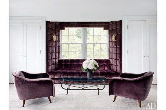 Aubergine-Sahco-velvet-is-used-for-this-luxuriously-padded-windowseat-and-Joaquim-Tenreiro-chairs-in-Greenwhich-Connecticut-home-decorated-by-Joe-Nahem-via-AD-770x513