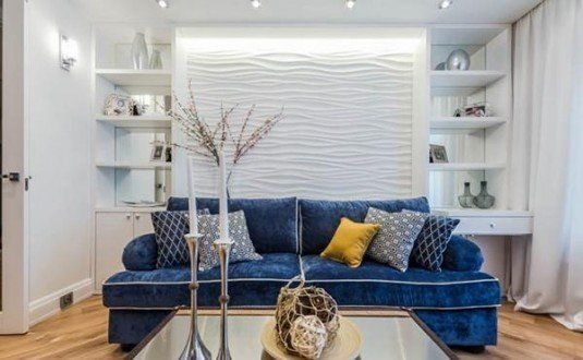 Modern-blue-sofa-in-the-white-living-room