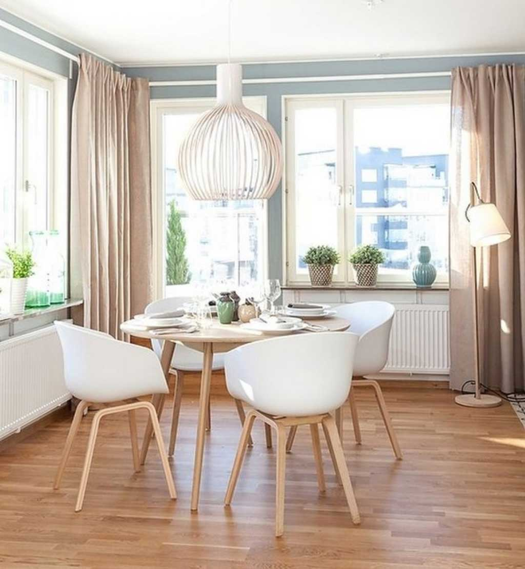 Stunning round tables that will impress you for Creative dining room table ideas