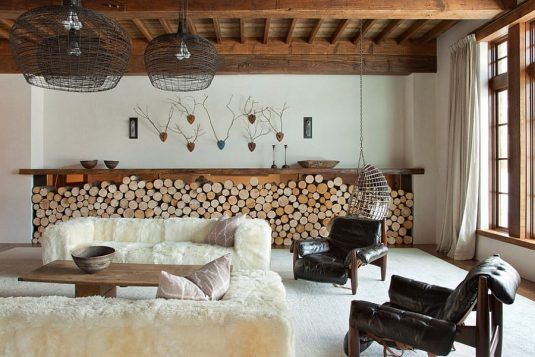Ingenious-firewood-storage-complements-the-low-slung-style-of-the-room