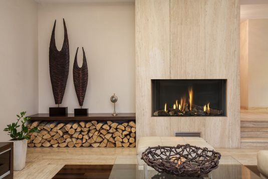 nice-interior-fireplace-wood-storage-on-dark-brown-wooden-table-with-cozy-rest-room