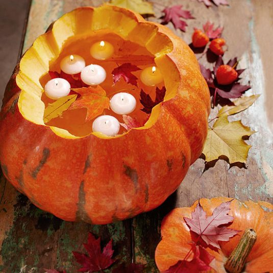 carved-pumpkins-with-floating-candles