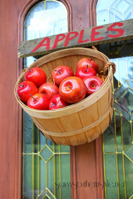 diy-projects-ideas-fall-wreaths-hang-a-bushel-basket-of-apples-on-the-door-idea-via-savvy-southern-style